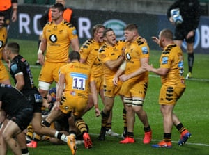 Jack Willis of Wasps celebrates with teammates after winning a turn over ball.