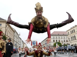 Acrobats take part in the parade