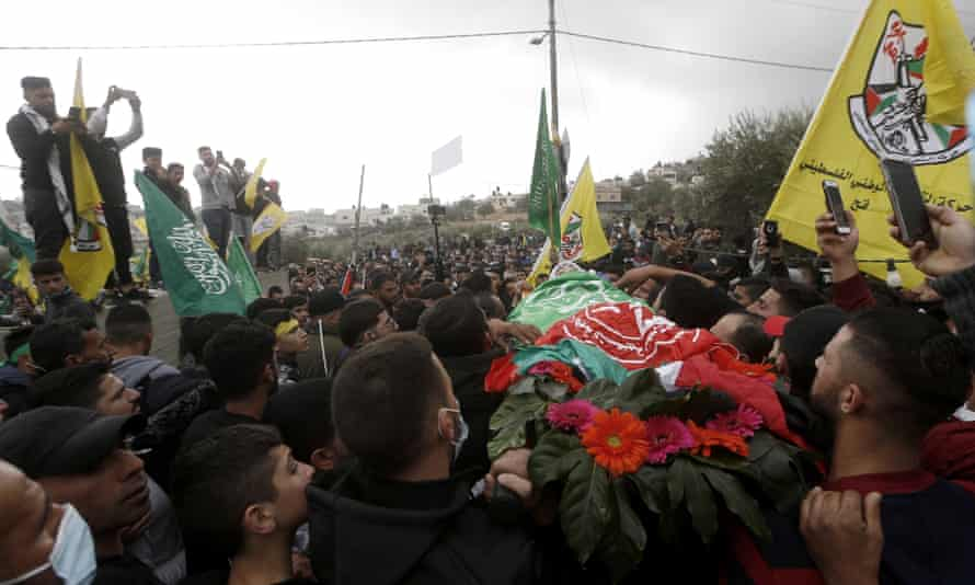 Ali Ayman Abu Aliya, 13, was buried in his home village near Ramallah after a large funeral.