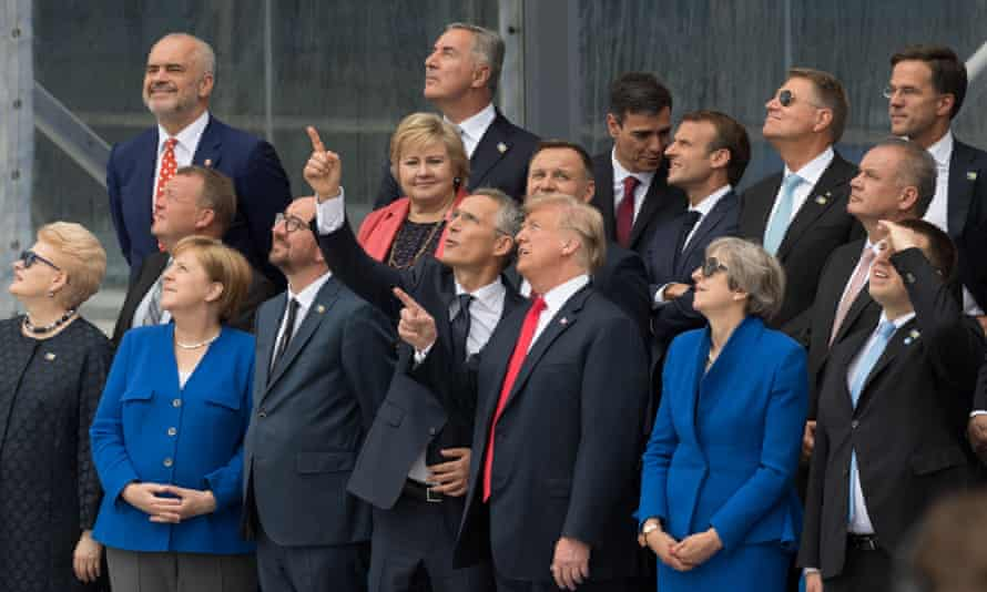 Donald Trump and Theresa May join other leaders of Nato member states as well as its secretary general, Jens Stoltenberg, for an aerial display in Brussels
