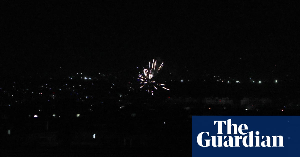 Celebratory shots ring out above Kabul after US troops leave – video