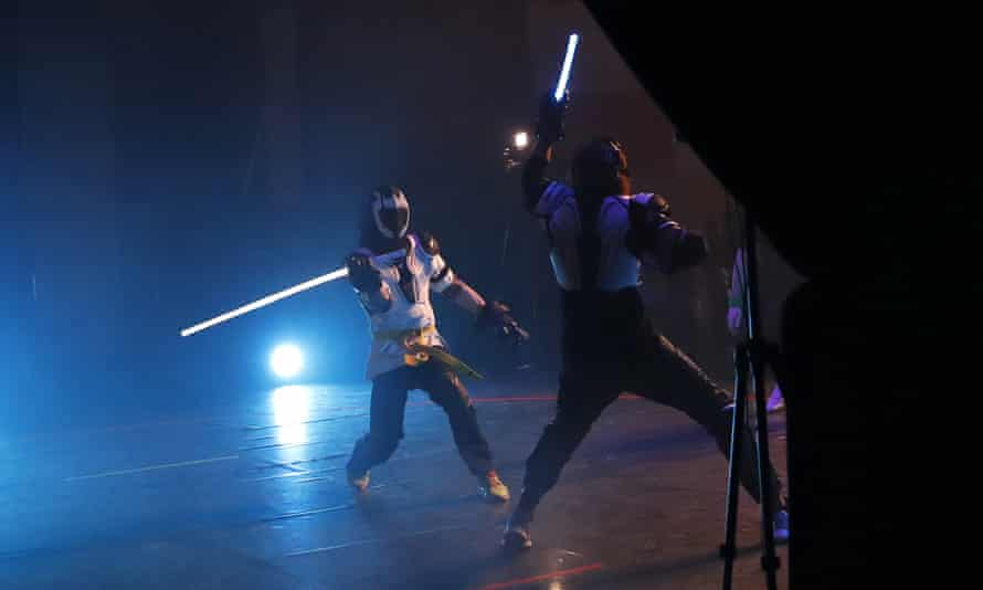 Buzzing … competitors fight it out in a national lightsaber tournament in Beaumont-sur-Oise, north of Paris.