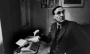 William S. BurroughsAuthor William S. Burroughs sitting at a crude table with typewriter, holding a cigarette and looking away. (Photo by Loomis Dean//Time Life Pictures/Getty Images)