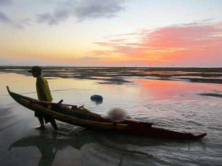 Oslob fisherman return after a day's work
