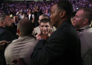 Finally, metro police restore order and Nurmagomedov is held back by security – his victory marred by the ugly fracas.