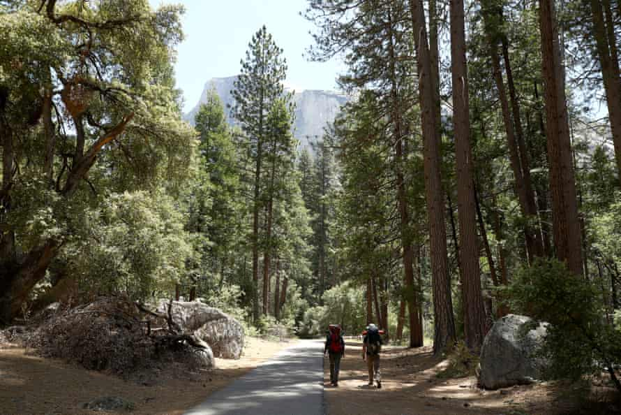 Yosemite national park visitors go backpacking on the park's first day of reopening after being closed for coronavirus restrictions.