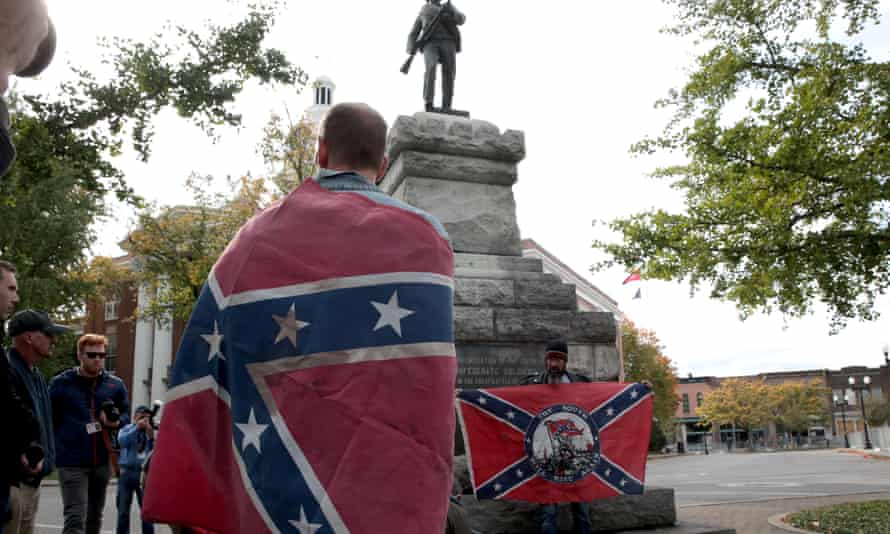 People hold Confederate flags during the 'White Lives Matter' rally in Murfreesboro.