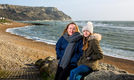 Anya Pearson and her daughter Evie Swire at Ringstead Bay, Dorset.