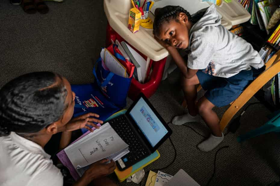 Cherokeena works with Mai'Kel on his distance-learning first grade homework in their private room in the transitional house that the organization Family Promise helped them find.