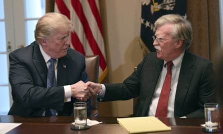 Donald Trump shakes hands with John Bolton