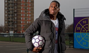 Aaron Wan-Bissaka, pictured on a visit to his primary school, is the Premier League's best one-on-one defender but has never been taught to tackle. 'I have no idea where I get it from.'