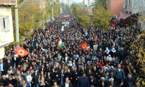 Mourners follow vehicle transporting coffin of Kurdish lawyer Tahir Elci