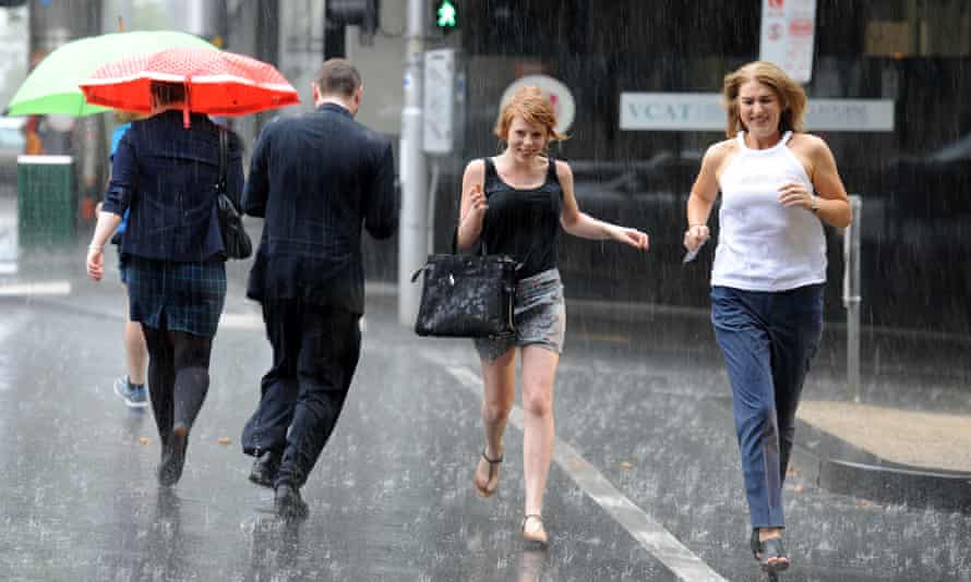 people getting caught in rain downpour