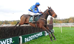 A horse jumping a fence in the Cork Grand National Handicap Chase
