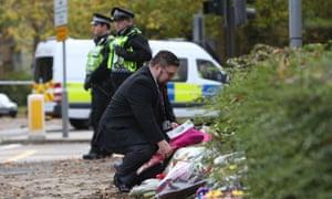 The mayor of Croydon lays flowers near the crash scene