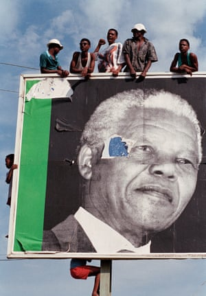 ANC supporters in Ladysmith, Kwazulu Natal, come out to greet the party's leader, Nelson Mandela, on the campaign trail in April 1994 - 10 days before the start of voting in South Africa's first democratic general election