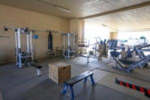 Afghan army soldiers take a break inside a gym at Bagram.