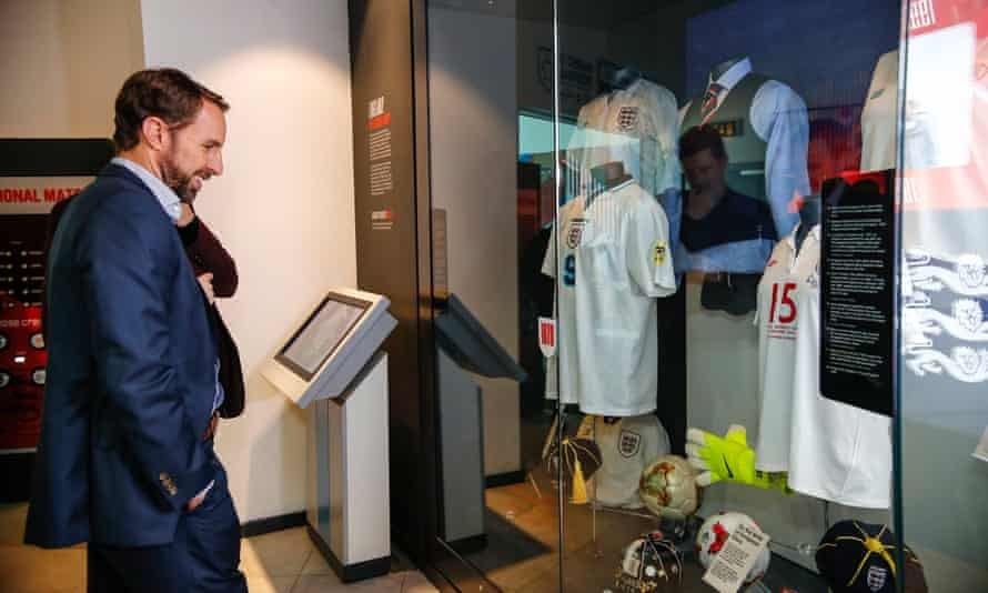 Gareth Southgate at the National Football Museum in 2019, looking at a display showing the waistcoat worn at the 2018 World Cup in Russia