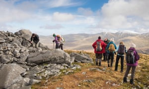 Group of Ramblers taking a break on Carnedd y Filiast part of Marchlyn horseshoe in Snowdonia National Park North Wales UK
