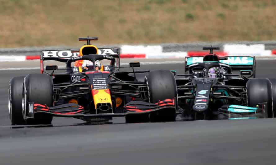 Max Verstappen and Lewis Hamilton in action at the end of the race.