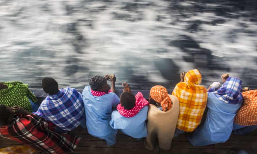African refugees and migrants, mostly from Sudan and Senegal, look at the sea aboard Golfo Azurro, the Spanish NGO Proactiva Open Arms rescue ship, after being rescued from a boat out of control at 25 miles north of Sabratha, off the Libyan coast, early in the morning on Thursday Feb. 23, 2016. (AP Photo/Santi Palacios)