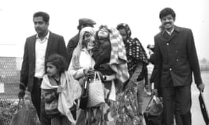A family arrive at Stansted Airport after being airlifted from Uganda