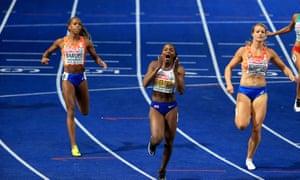 Dina Asher-Smith celebrates winning gold