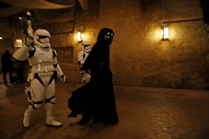 Stormtroopers and the character Kylo Ren are present
