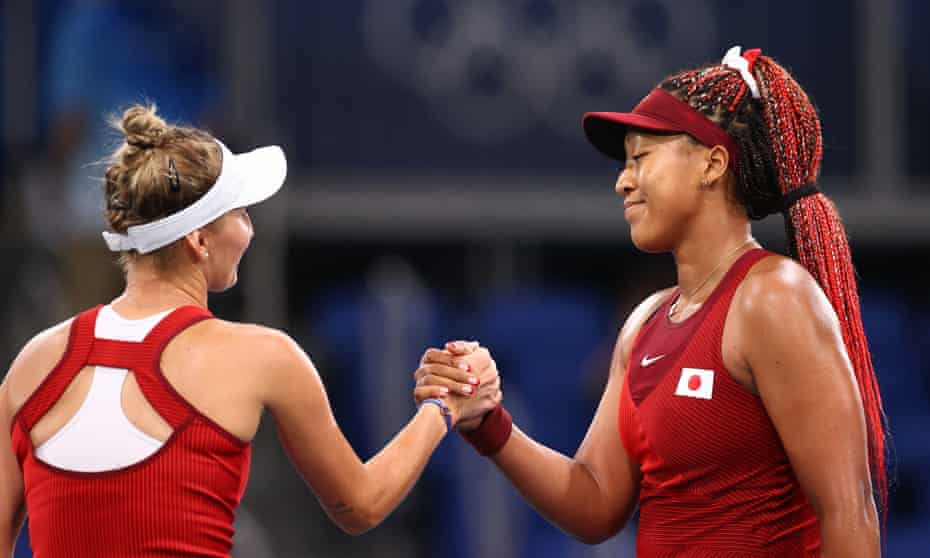 The Czech player Marketa Vondrousova shakes hands with Naomi Osaka as the Japanese bowed out of the Tokyo Olympics women's singles.