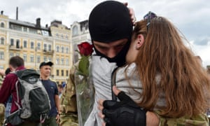 A young woman embraces her boyfriend, a new volunteer recruit of the Ukrainian army, in Kiev in 2014.