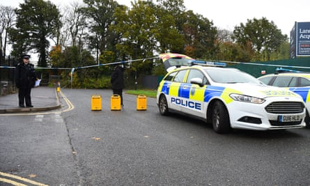 Police officers attend the scene on Russell Way in Crawley, West Sussex, after a 24-year-old man found with serious injuries.
