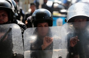 Riot police prepare to disperse protesters during a march to mark the one year anniversary of the protests against Nicaraguan president Daniel Ortega's government in Managua on 17 April 2019