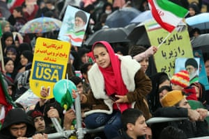 Iranians carry anti-US and anti-Israel banners and placards