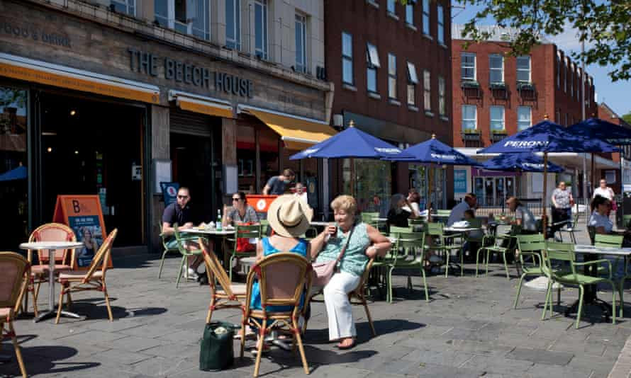 Customers enjoying the sunshine outside restaurants in St Albans.