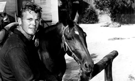 Tab Hunter, who died on Sunday at the age of 86, with his horse on 3 April 1967.