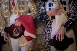 Most of the Spanish bullfighters are catholics. They pray before the fight and sometimes have some religious items with them in the arena