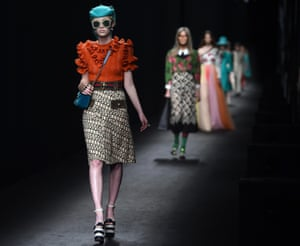 Models on the catwalk for Gucci's AW16 collection.