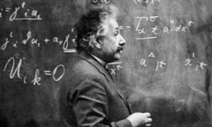 Einstein's Equationscirca 1931: German-born physicist Albert Einstein (1879 - 1955) standing beside a blackboard with chalk-marked mathematical calculations written across it. Gravitational wave discovery