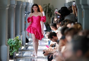 Mexico City, Mexico. A model wears a Pink Magnolia dress during Mercedes-Benz fashion week