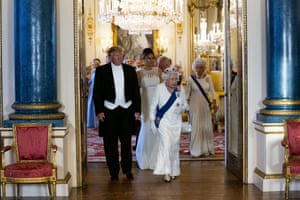 President Trump and first lady Melania Trump walk with Queen Elizabeth II as they make their way into the Music Room for the State Banquet