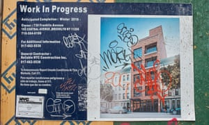 A defaced poster showing an impending Crown Heights development