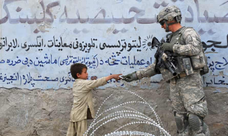 US soldier gives a gift to a child in Afghanistan
