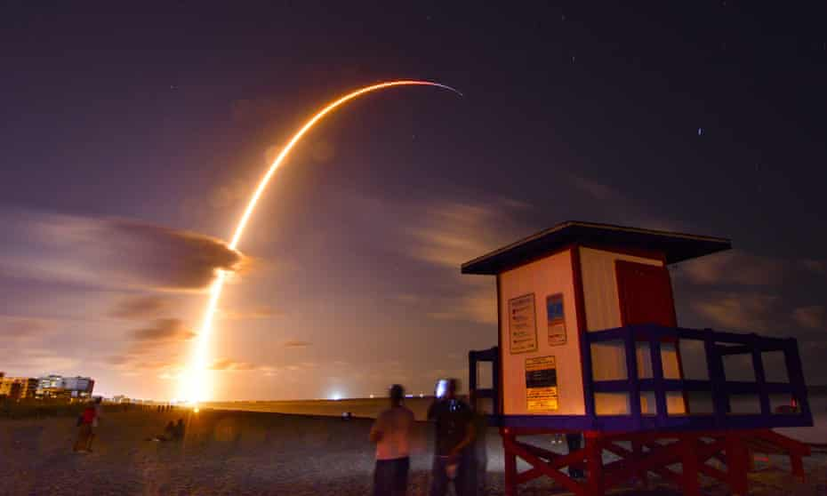 A SpaceX rocket, with 60 satellites for the  Starlink broadband network, lifts off from Cape Canaveral.