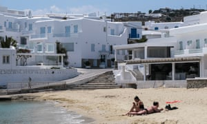 Platis Gialos Beach remains nearly empty at the beginning of the delayed tourist season in Mykonos, Greece.