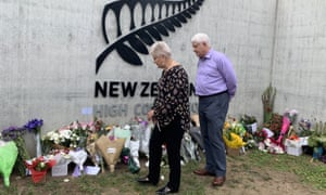 Dame Annette King and her husband, Ray Lind, look at flowers left outside the New Zealand high commission in Canberra