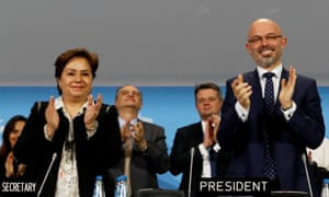 COP24 president Michal Kurtyka and UN climate chief Patricia Espinosa react after adopting the final agreement during the closing session of the conference in Katowice, Poland
