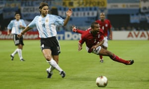 Mauricio Pochettino sends Ashley Cole flying during the World Cup group game in Sapporo on June 7, 2002.