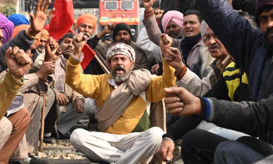 Activists block rail tracks near Amritsar train station.