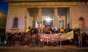 Atlantide's members gather on the steps of anarchist group Circolo Anarchico Berneri's premises, just across the road from Atlantide, on the morning of 9 October.