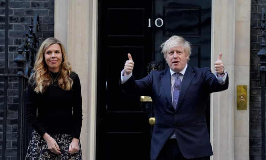 The prime minister with his fiancee, Carrie Symonds, outside No 10.